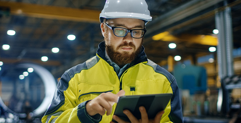 Factory worker using a computer tablet