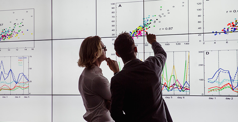 Two people reviewing charts
