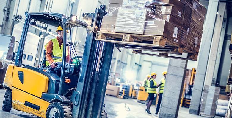 Forklift moving boxes in a warehouse