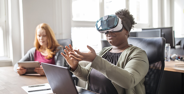 Office worker using a virtual-reality headset.