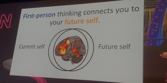 A sign reads: First-person thinking connects you to your future self.