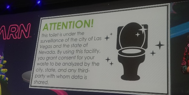 "A sign says: ""Attention! This toilet is under the surveillance of the city of Las Vegas and the state of Nevada."""