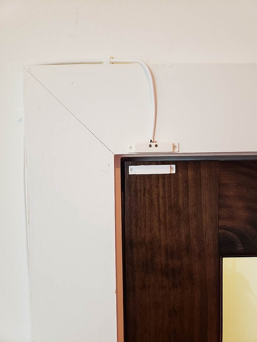 A small sensor attached to the top of the conference room door uses xAPI and Internet connectivity to send status data.